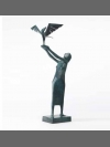 Woman Releasing Bird by Terence Coventry