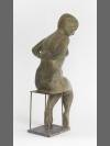 Woman Undressing by Terence Coventry